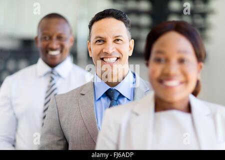 group of happy business executives standing in a row - Stock Image