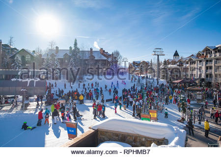 Crowds of people at the bottom of the Village Express chairlift in Mountain Village, San Miguel County, Colorado, USA - Stock Image