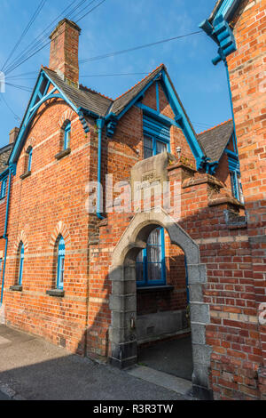 1875 almshouses on Middle Street in Padstow, Cornwall, England - Stock Image