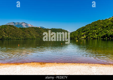 Lake, mountains and beach at Levico Terme, Trentino, Italy - Stock Image