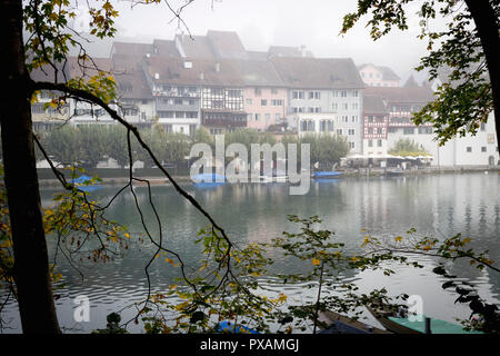 The town of Eglisau reflected on the Rhine River on a foggy morning, Canton of Zurich, Switzerland. - Stock Image