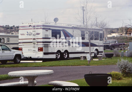 Large recreational vehicle parked at a campsite ca. 1995 - Stock Image