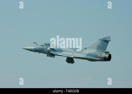 French Air Force Armée de l'Air Dassault Mirage 2000C fighter jet plane flying at the Royal International Air Tattoo, Cotswolds, UK. Space for copy - Stock Image