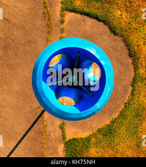 Pole aerial High Dynamic Range (HDR) image of a blue funnel ball structure on a playground. - Stock Image
