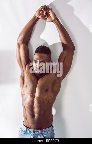 African American bodybuilder man, naked muscular torso - Stock Image
