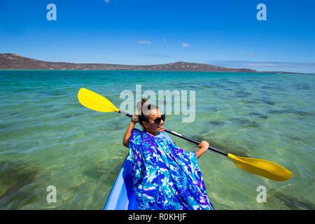 Woman kayaking in the Langebaan Lagoon in the West Coast National Park - Stock Image