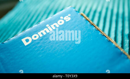 Domino's Pizza delivery box. Domino's Pizza Inc, An American take away pizza chain founded in 1960 - Stock Image