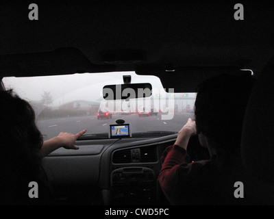 November 2010 Driving in fog on the M6 motorway. Approaching the north bound M6 toll payment booths. Using Sat Nav - Stock Image