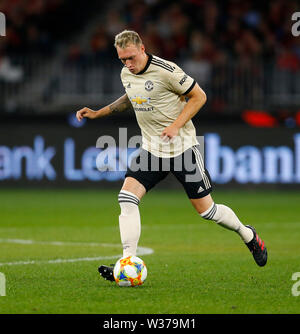Optus Stadium, Perth, Western Australia. 13th July, 2019Optus Stadium, Perth, Western Australia. 13th July, 2019. Pre-season friendly football, Perth Glory versus Manchester United; Phil Jones of Manchester United passes the ball inside Credit: Action Plus Sports/Alamy Live News Credit: Action Plus Sports Images/Alamy Live News - Stock Image