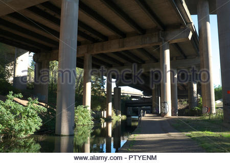 A view of a section of the underside of the Gravelly Hill Interchange (aka Spaghetti Junction), and the Tame Valley Canal. Birmingham, West Midlands,  - Stock Image