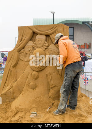 Redcar Cleveland UK 28 May 2018  The seaside town of Redcar on the Yorkshire Coast is commemorating the events of 1918. With construction of Sand Sculptures by an international team of specialists commemorating events by local people during the first World War.  This sculpture commemorates Billy Scarrow who fought in the trenches as a teenager but survived to work in films and later formed a Pierrot Show called Cosy Corner Entertainers in Redcar Credit: Peter Jordan_NE/Alamy Live News - Stock Image