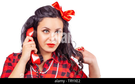 portrait of brunette woman in red dress with phone in pinup and vintage style isolated on white - Stock Image