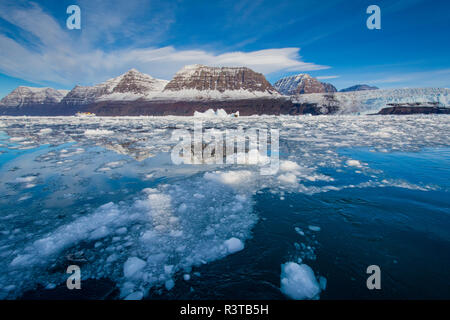 Greenland, Scoresby Sund, Gasefjord. Brash ice with mountains beyond. - Stock Image