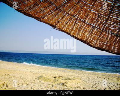 Beach and umbrella - Stock Image