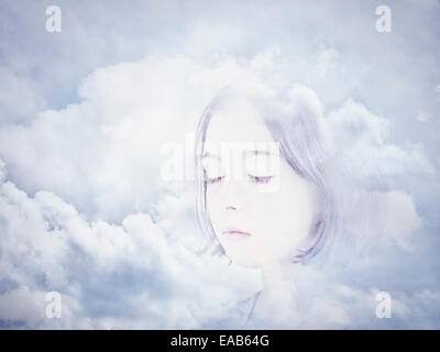 Face in clouds. Digital composite. - Stock Image