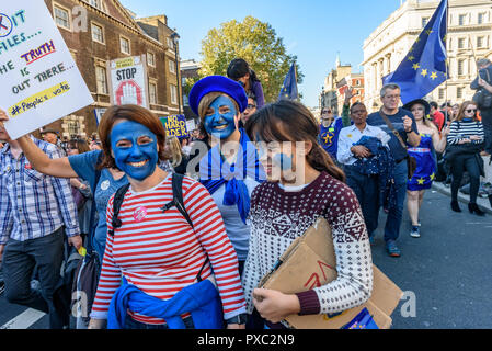 London, UK. 20th October 2018. Marchers come down Whitehall at the end of the People's Vote March calling for a vote to give the final say on the Brexit deal or failure to get a deal. They say the new evidence which has come out since the referendum makes it essential to get a new mandate from the people to leave the EU. With so many on the march the crowding meant many failed to reach Parliament Square and came to a halt in Whitehall. Peter Marshall/Alamy Live News - Stock Image