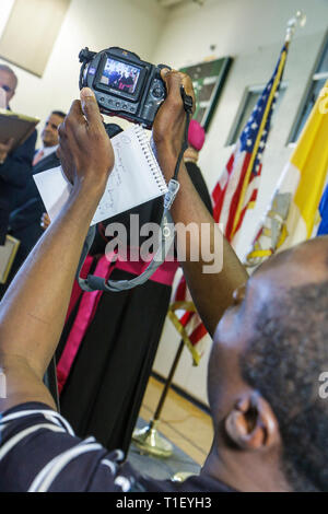 Miami Coconut Grove Florida LaSalle Catholic High School street naming ceremony Most Reverend Augustin Roman Way Black man Haiti - Stock Image