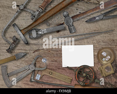 vintage jeweler tools and diamonds over wooden bench, space for your business name - Stock Image