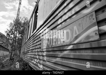 Detail of sleeping car train covered by graffiti at the abandoned Canfranc International railway station (Canfranc,Pyrenees,Huesca,Aragon,Spain) B&W - Stock Image