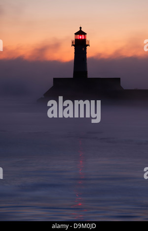 Winter morning view of north pier lighthouse in Duluth, Minnesota. - Stock Image