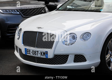 Monte-Carlo, Monaco - June 16 2019:  Luxury English Cars, White Bentley Continental GT And Black Land Rover Range Rover Evoque Parked On The Casino Sq - Stock Image