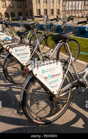 Spain, Galicia, A Coruna, Bicicoruna, public bicycles in rack at Cruise Terminal dock - Stock Image