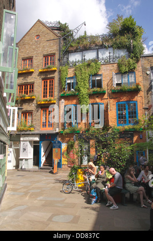 Neal's Yard Covent Garden London Wild Food cafe in background - Stock Image