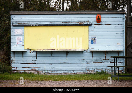Weathered shed at a car park at Holme on the Norfolk coast, closed for the Winter. - Stock Image
