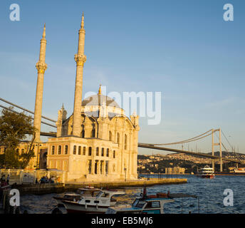 Ortakoy Mosque by the Bosphorus bridge in Istanbul Turkey - Stock Image