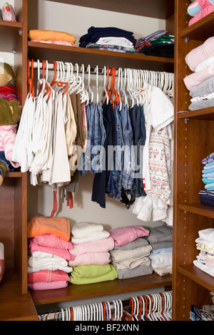 Clothes in a closet - Stock Image