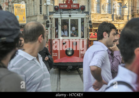 The vintage tram on Istiklal street in central Istanbul.  The tram operates an all-day regular service between Taksim - Stock Image