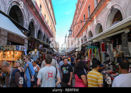 Venice, Italy, one of the main shopping streets souvenir from Venice, where crowds of tourists and shopping - Stock Image