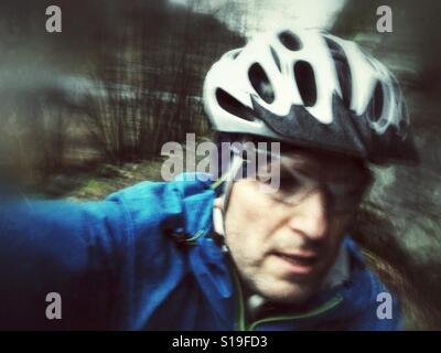 Action selfie during bike ride. - Stock Image
