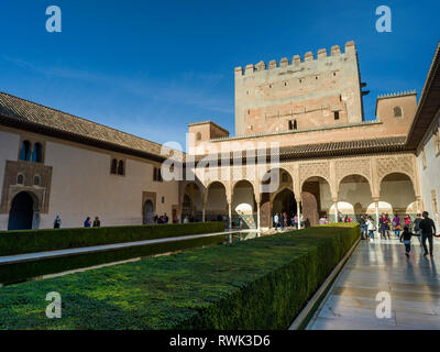 Tourists in Court of the Myrtles at the Alhambra; Granada, Spain - Stock Image