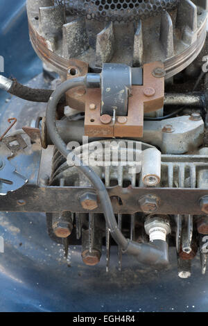 Magneto ignition system on a lawn mower used to produce a high Voltage for the spark plug, - Stock Image