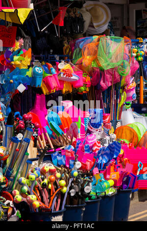 UK, Cornwall, Padstow, North Quay, colourful plastic beach toys on display - Stock Image