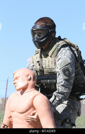 Sgt. 1st Class Erik Hart, Special Operations Detachment - North, drags a mannequin simulating an injured Soldier - Stock Image