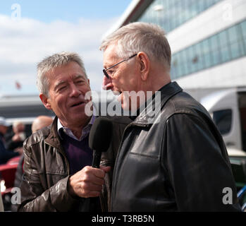 Tiff Needell interviewing Steve Neal, at the 2019 Silverstone Classic media Day. Steve is a former British Saloon Car Championship driver  who raced Minis and farther of BTCC legend Matt Neal. - Stock Image
