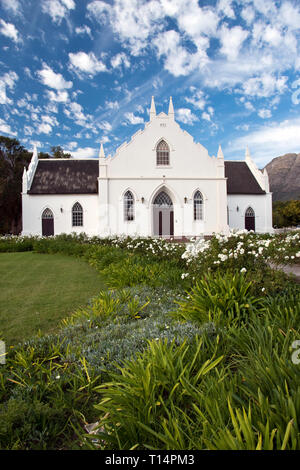 The Dutch Reformed Church in Franschhoek, South Africa, is built in the Cape Dutch style. - Stock Image