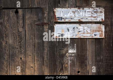 Weathered Ladies and Men restroom signs, China Camp State Park, San Rafael, California, USA - Stock Image