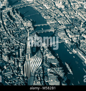 Split tone image of aerial view of Central London from above the Shard with views along the Thames from HMS Belfast - Stock Image
