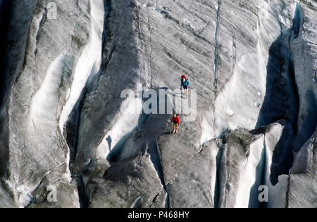 Climbers and their shadows on the glacier Trelatete and crevasse in the French Alps - Stock Image