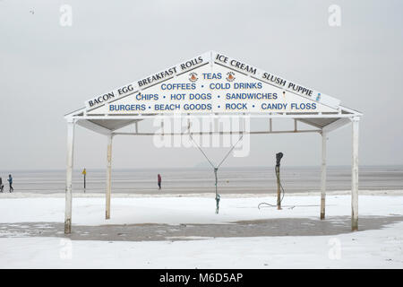 The beach, Weston super mare. UK. 2nd March, 2018. Snow on the beach near a beach side vendors shelter. Credit: - Stock Image