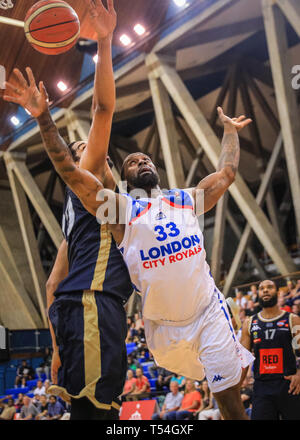 London, UK, 20th April 2019. Royals' Sam Toluwase (33) breaks through the Glasgow defense. Tensions run high in the London City Royals v Glasgow Rocks BBL Championship game at Crystal Palace Sports Centre. Home team LCR win the tight game 78-70. Credit: Imageplotter/Alamy Live News - Stock Image