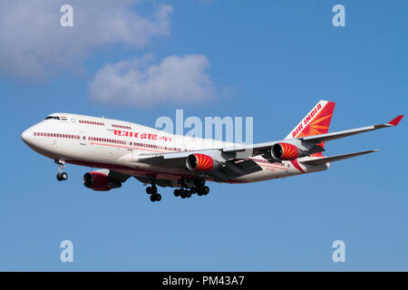Air India Boeing 747-400 jumbo jet plane flying on approach. Long haul air travel. - Stock Image