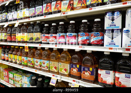 Shelves full of fruit juices for sale in a grocery market in Speculator, NY - Stock Image
