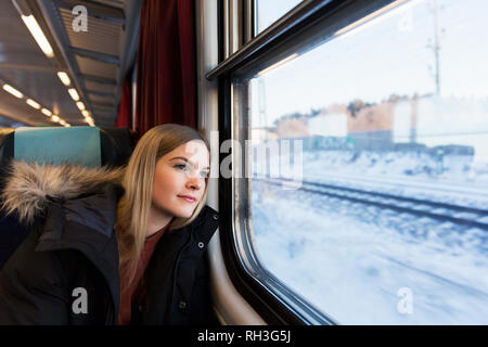 Youth woman in train - Stock Image