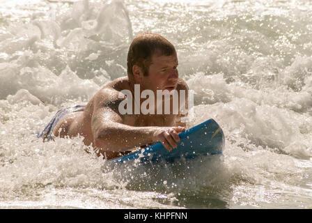 Bodysurfing on the Sunshine Coast, Queensland, Australia - Stock Image