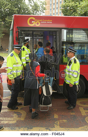 London, UK. 6th Aug, 2015.  Police monitor commuters An extra 250 buses, including the older routemaster models, - Stock Image