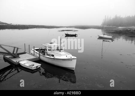 Lobster boat in Maine harbor on foggy day - Stock Image